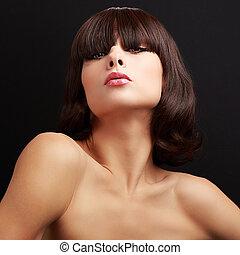 Sexy short hair alluring model posing. Closeup on black background