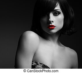 Sexy short hair woman with red lips in darkness. Black and...