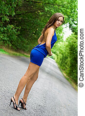 Sexy slim brunette - Sexy brunette in blue dress on the road
