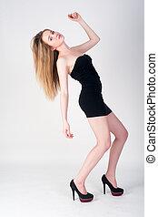 Sexy slim woman in black dress