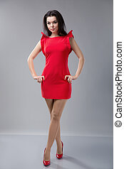 Sexy slim woman in red dress