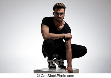 sexy smart casual man standing in a fashion pose