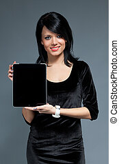 Sexy smiling girl with new touchpad