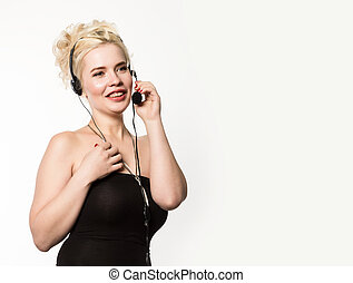 Sexy smiling woman working in a call center. Headset telemarketing woman talking on helpline. free space for your text