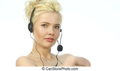 Sexy smiling woman working in a call center. Headset...