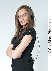 Sexy smilling call center operator. Girl wearing headset...