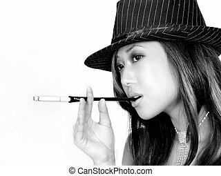 Beautiful Asian girl smoking a cigarette