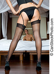Sexy Stockings - A sexy woman in lingerie standing in front...