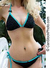 Sexy stomach of a woman in a bikini