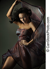 Sexy stunning brunette beauty in a romantic pose