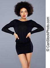 Sexy stylish African American woman in black