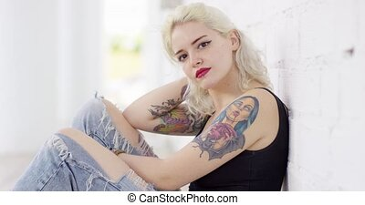 Sexy sultry young woman with a vampire tattoo