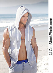 Sexy summer guy - Handsome very muscular young man at beach