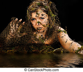 Sexy Swamp Creature - Beautiful woman covered in mud and ...