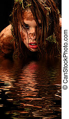 Sexy Swamp Creature - Beautiful young woman covered in mud...