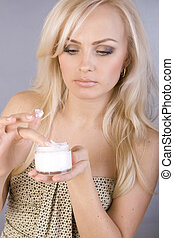 sexy sweet girl with a jar of cream