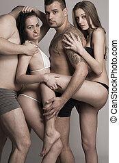 sexy, swinger, groupe de quatre personnes, dans, lingerie