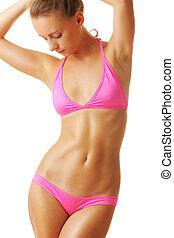 Sexy tan woman in bikini isolated on white background