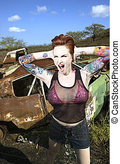 Sexy tattooed woman. - Sexy tattooed Caucasian woman yelling...