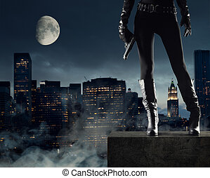 Sexy Female thief with gun, new york on background