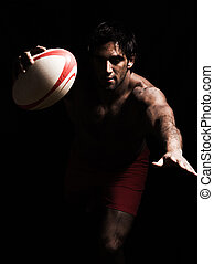 sexy topless rugby man scoring touchdown - one caucasian...