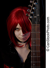 Sexy vampire girl with guitar
