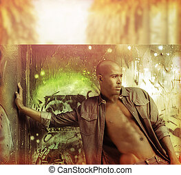 Sexy stylized fashion portrait of male model against urban wall in golden vintage tones