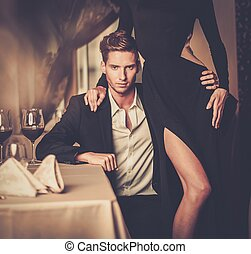 Sexy well-dressed young couple in luxury interior - Sexy...