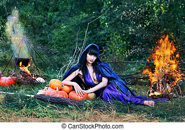 sexy witch near a fire