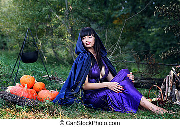 sexy witch near pumpkins