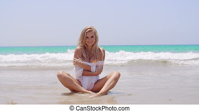 Sexy Woman at the Beach Smiling at the Camera