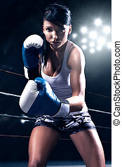Sexy woman boxing - Sexy beautiful woman boxing, looking at...