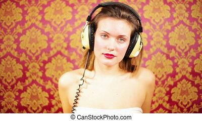 sexy woman dances with headphones