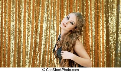 Sexy Woman dancing party gold glitter background