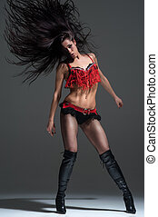 Sexy woman dancing. Photo in a studio