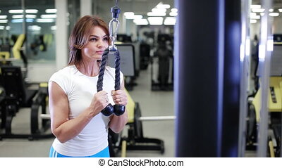 sexy woman doing exercise in gym - woman doing exercise in...