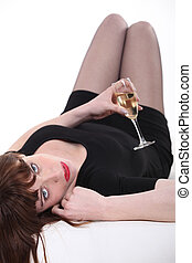 Sexy woman drinking wine