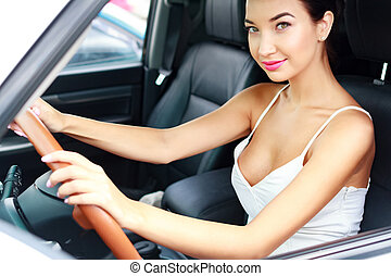Sexy woman driver in a car