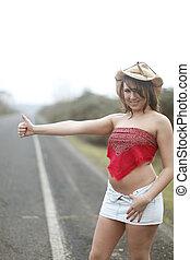 Sexy woman hitchhiking