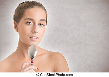 Sexy Woman Holding a Spoon