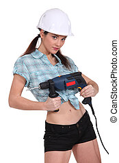 Sexy woman holding an electric screwdriver