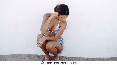 Sexy Woman in Bikini Top and Short Jeans