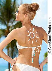 Sexy Woman in Bikini with Sun Drawing on Skin