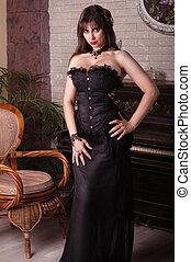 sexy  woman in black dress  near piano.