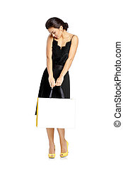 sexy woman in black dress with shopping bags
