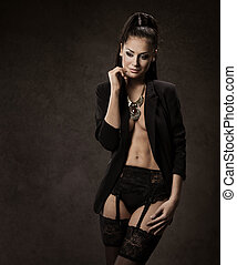 Sexy Woman in black stockings and jacket over dark background