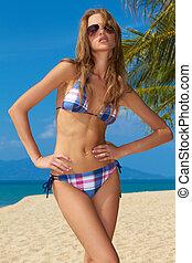 Sexy woman in checkered bikini