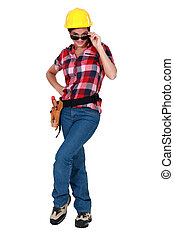 sexy woman in craftsman overalls wearing sunglasses