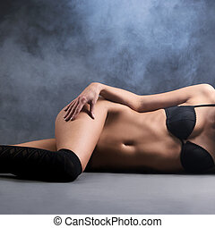 Sexy woman in erotic lingerie fashion shoot