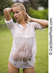 sexy woman in garden - young sexy blond woman outdoor in a...